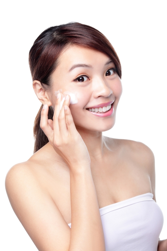 Asian woman cleansing her face.