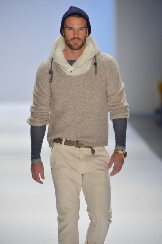 Male model on the runway in fall clothing