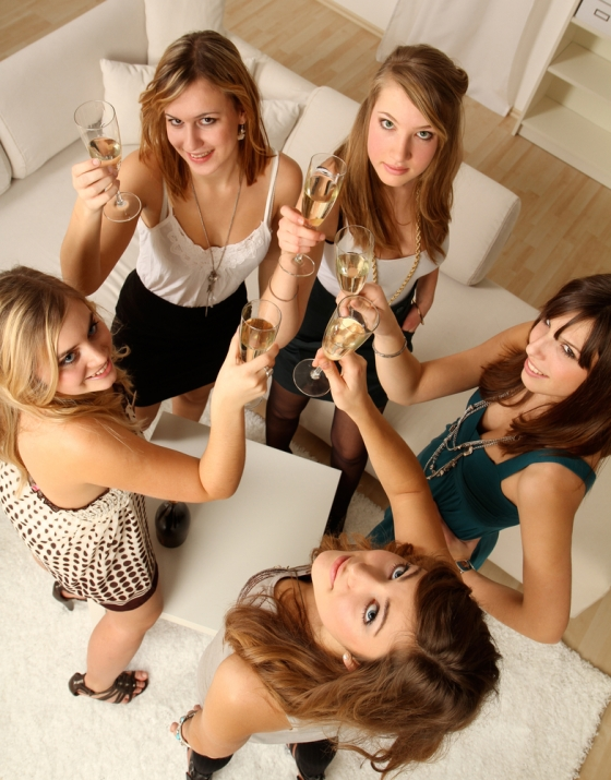 Women having champagne at a home party