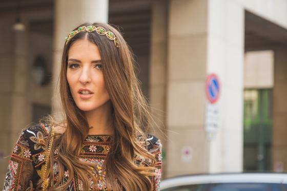 Woman wearing a stylish headband.