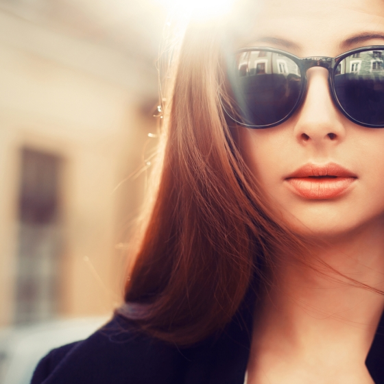 Woman wearing sunglasses.