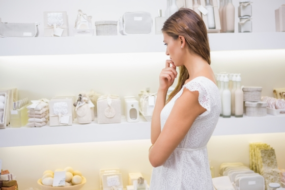 Woman examining makeup