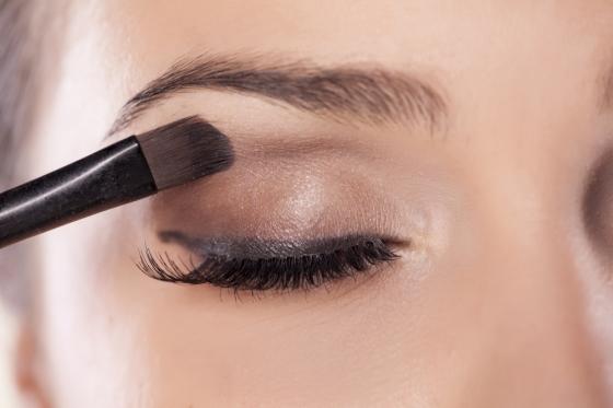 Woman applying eyeshadow.