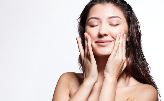 Woman exfoliating skin