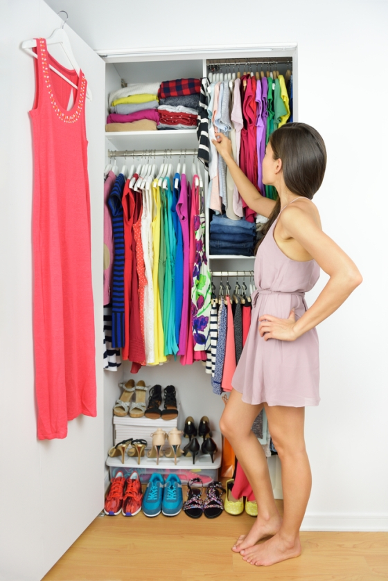 Woman deciding on what to wear