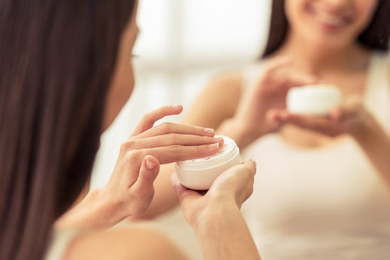Woman using a moisturizer