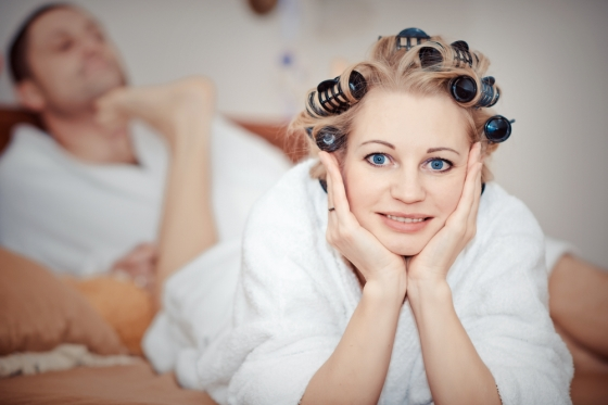 Woman using hair rollers
