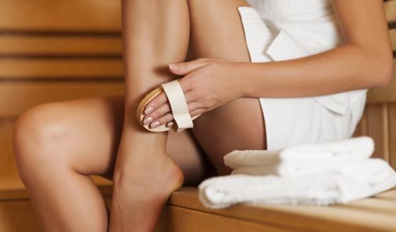 Woman brushing legs