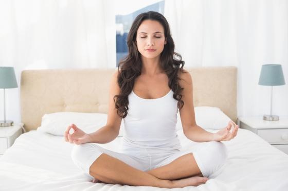 Woman performing meditative breathing