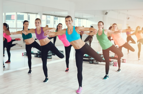 Woman taking exercise class