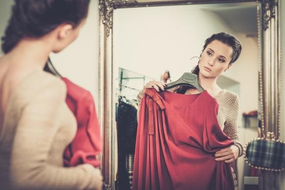 Woman looking at dresses