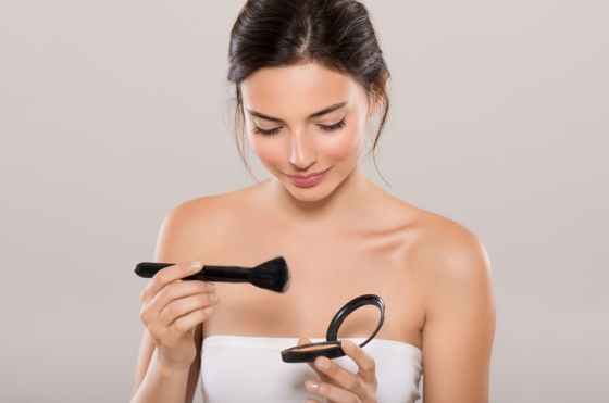 Woman putting on foundation powder