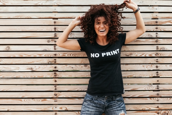 Woman with curly hair in shirt