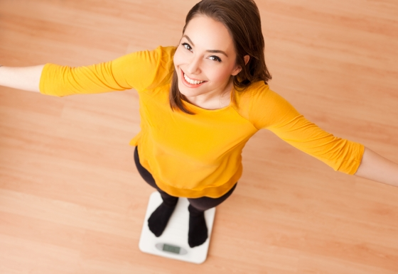 Woman standing on weighing scale
