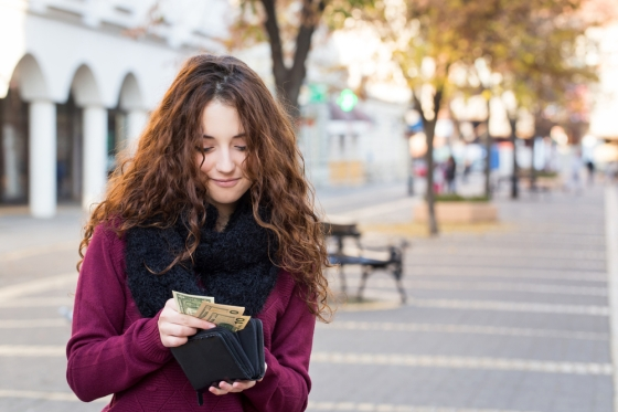 Woman using travel wallet