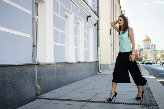 Woman with culottes on the way to work