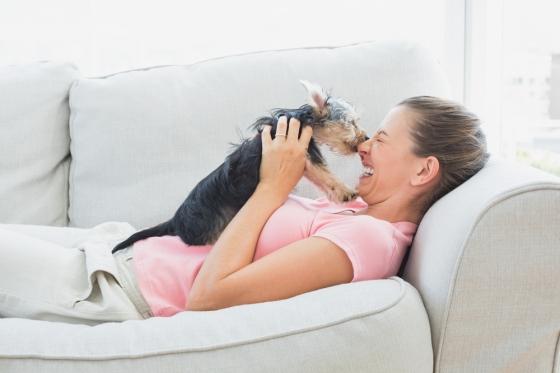 Woman cuddling dog