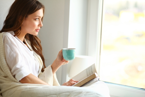 Woman relaxing by reading