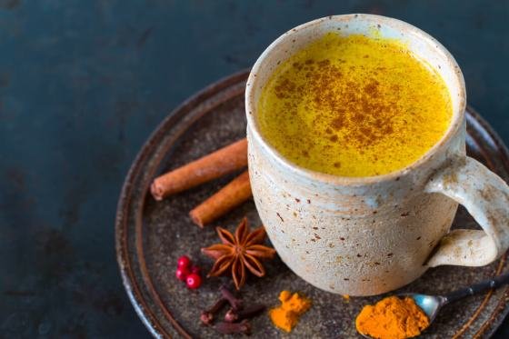 A cup of golden milk made of turmeric