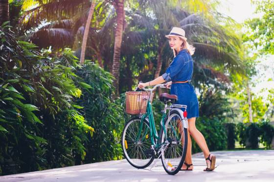 Woman in denim dress with bicycle