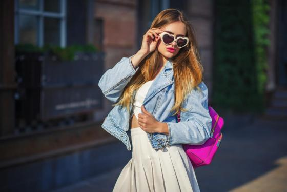 Fashionable woman with denim jacket