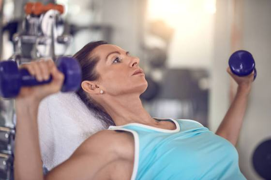 Middle aged woman doing strength training