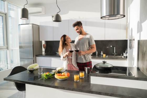 Couple in spacious kitchen at home
