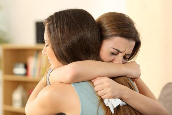 Woman hugging her crying friend