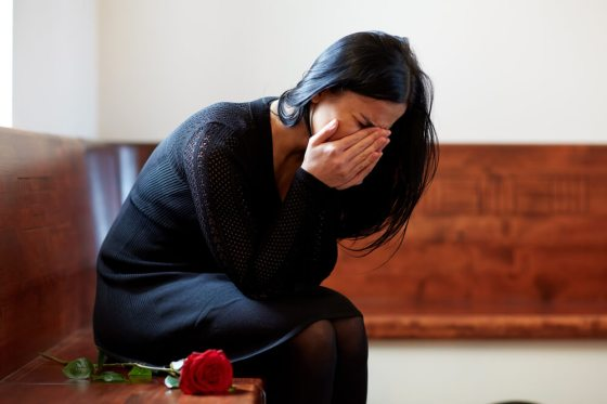 Grieving woman in black