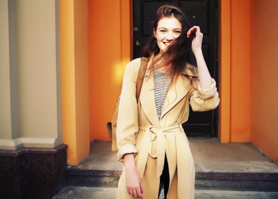 Smiling woman in brown coat