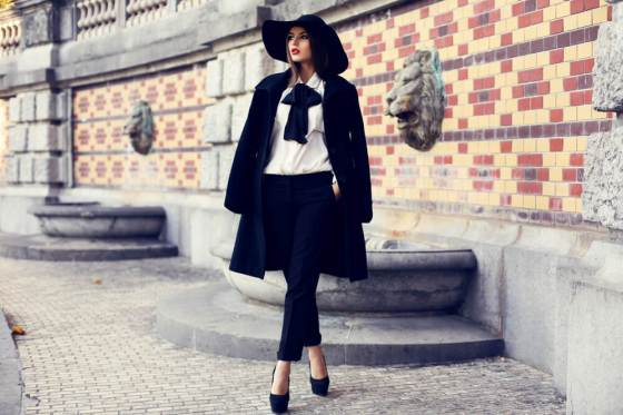 Stylish woman in coat and hat