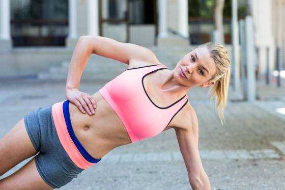 Woman exercising in sports bra