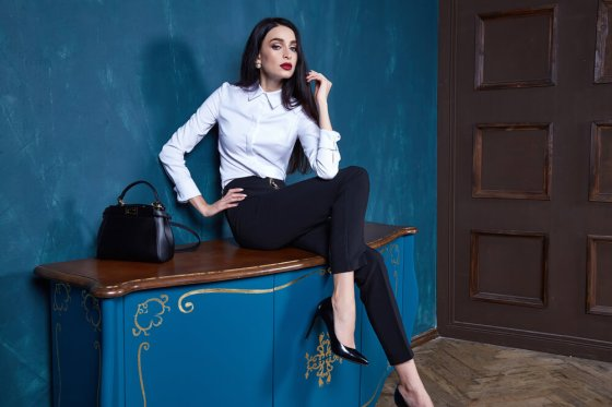 Woman posing in business casual outfit