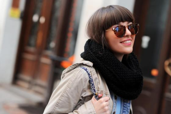 Woman with shades and oversized scarf