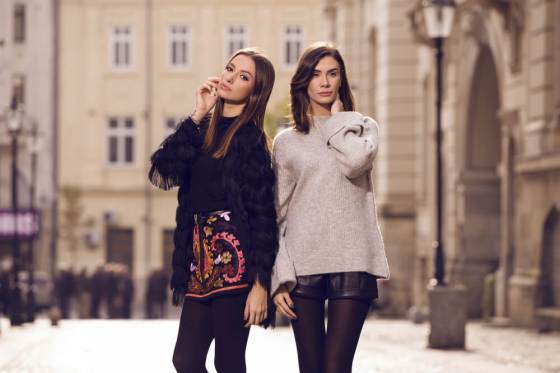 Two women posing in fall fashion