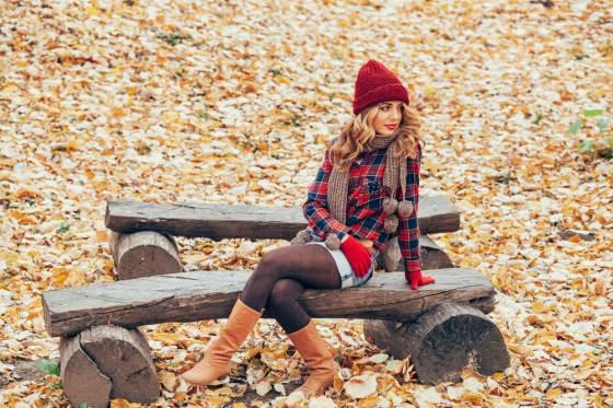 Woman in fall fashion and leggings