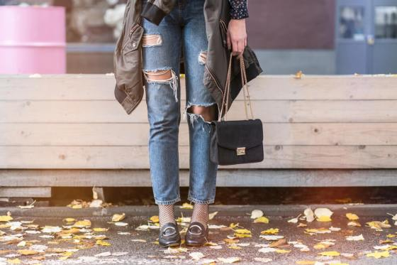 Woman posing with loafers as part of fall fashion