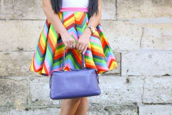 Woman with colorful bold striped skirt