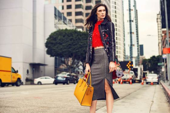 Fashionable woman in striped skirt