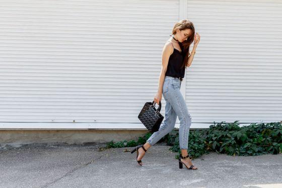 Woman walking in cropped jeans