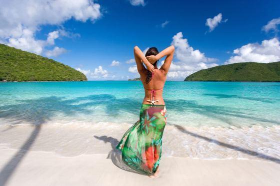 Woman wearing colorful sarong at beach